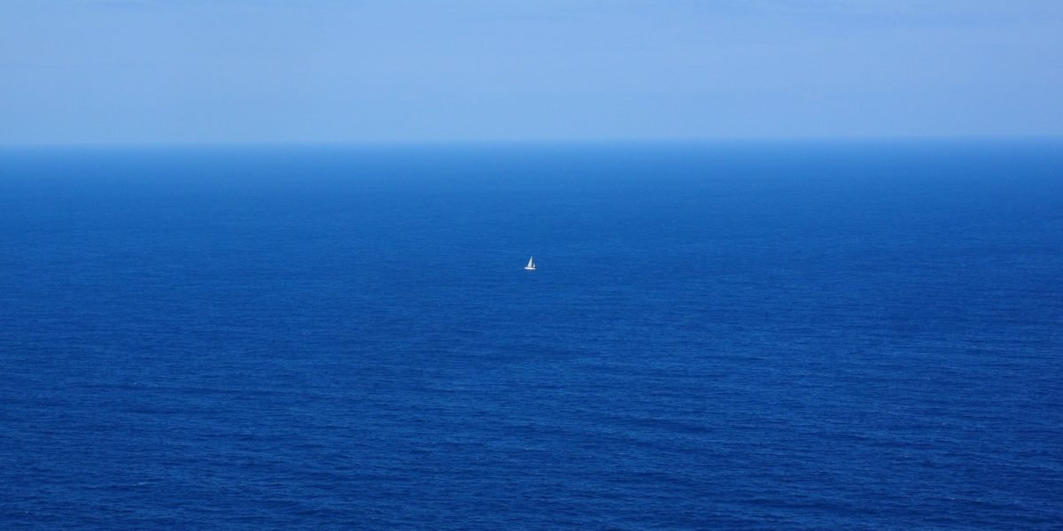 A boat in the middle of the sea